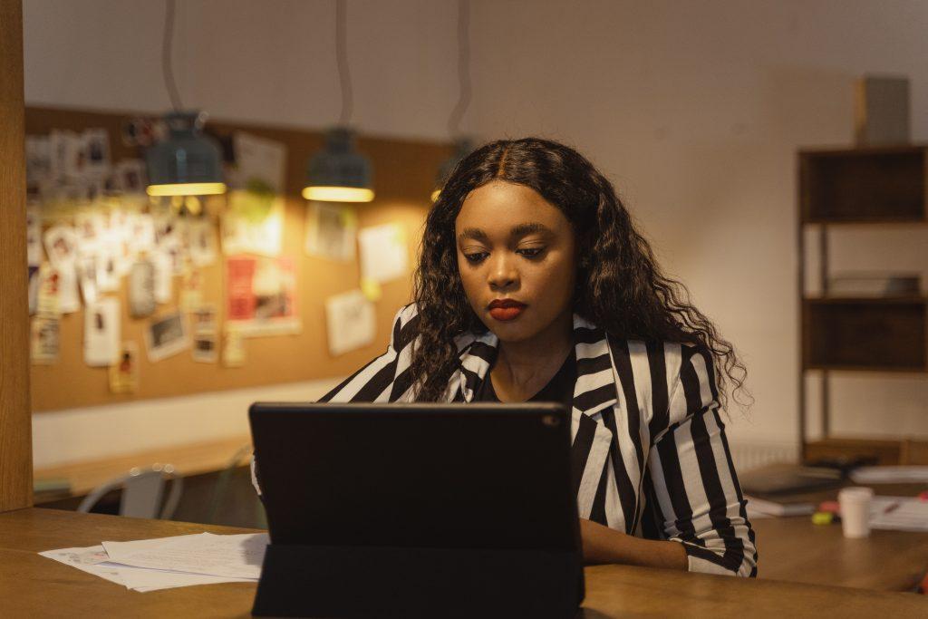 woman watching training video on laptop